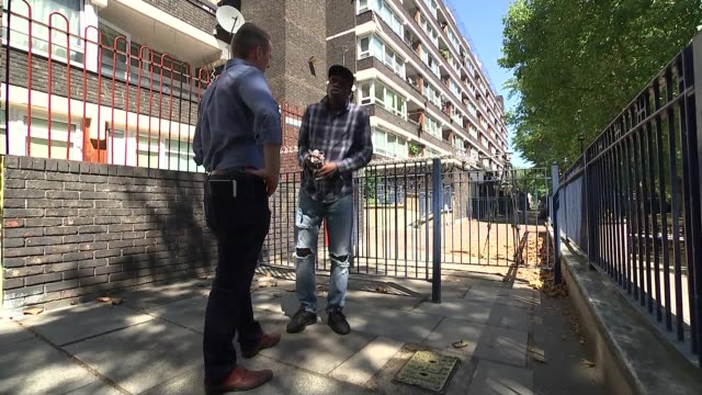 estate residents do not want to be defined by violence england london camberwell ext various of white forensic tent police car housing estate tyrone... - 刺傷事件点の映像素材/bロール