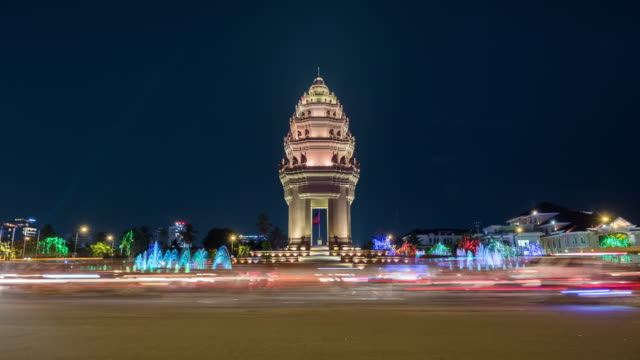 cambodia, phnom penh, independence monument at dusk - phnom penh stock videos and b-roll footage