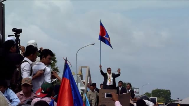 Cambodia s opposition leader calls for an end to a year long political crisis after a slew of arrests of rivals of strongman premier Hun Sen trigger...
