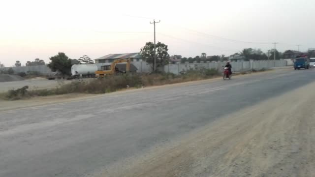 cambodian garment workers traveling on crowded trucks to factories taken at 600am on feb 17 on road 41 just outside phnom penh cambodia - arbeitsintensive produktion stock-videos und b-roll-filmmaterial