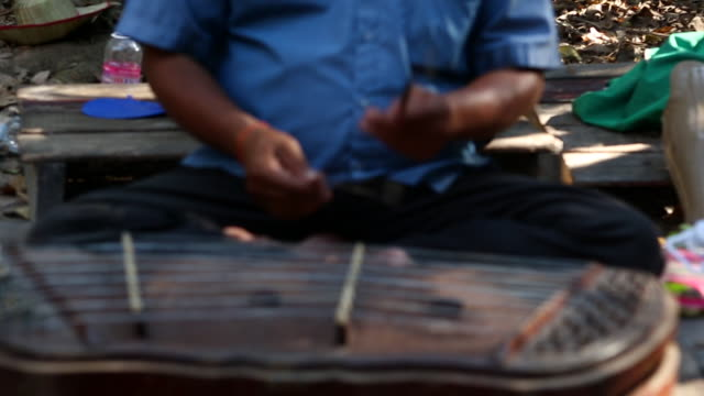 cambodian man playing a zither - stringed instrument stock videos & royalty-free footage