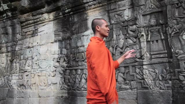 cambodian monks discuss bayon bas-reliefs - circa 12th century stock videos & royalty-free footage