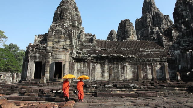 cambodian monks walking at bayon angkor thom - cambodia stock videos and b-roll footage