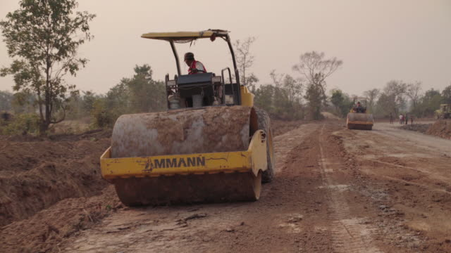 cambodian road construction - steamroller stock videos and b-roll footage