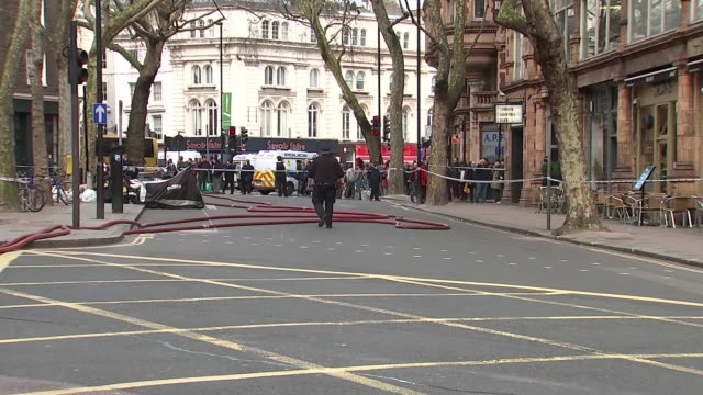 suspicious package england london new oxford street cambridge analytica headquarters ext firefighters gathered behind red police cordon tape / police... - data breach stock videos and b-roll footage