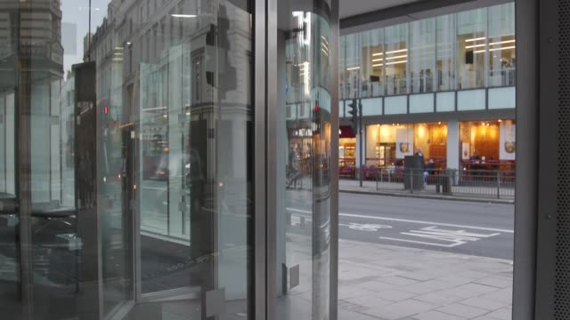 vacant london headquarters england london new oxford street ext placeholders with cambridge analytica sign missing / entrance / people along past /... - data breach stock videos and b-roll footage