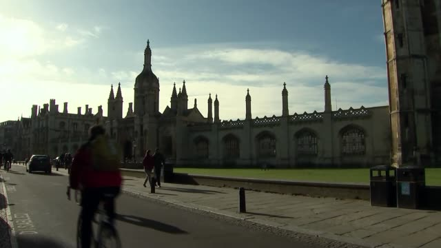whistleblower reveals data grab of 50 million facebook profiles r190218014 / cambridgeshire cambridge day wide shot university building cyclists along - data breach stock videos and b-roll footage