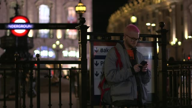 whistleblower reveals data grab of 50 million facebook profiles piccadilly circus shot of lights chris wylie looking at phone waterloo **wylie... - data breach stock videos and b-roll footage