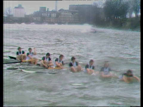 stockvideo's en b-roll-footage met cambridge boat sinking in 1978 boat race between oxford and cambridge river thames london - waden