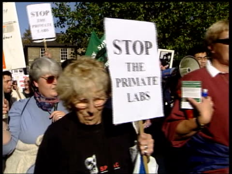 animal rights protesters marching along in demonstration against planned experimentation on primates at cambridge university - 2004 stock-videos und b-roll-filmmaterial