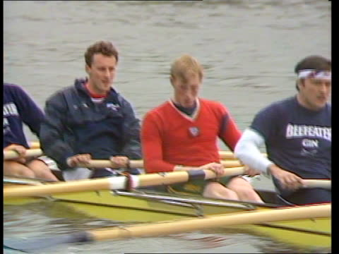cambridge team accuse oxford team of using semi-professional post-graduates for annual boat race; england: london: putney penny holding oar as... - oxford england video stock e b–roll