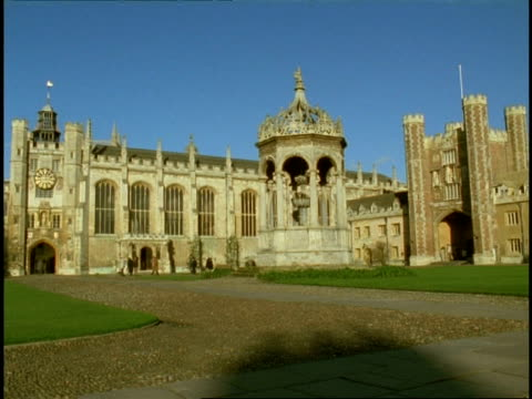 cambridge university, trinity college - wa people walking around courtyard - cambridge university stock videos and b-roll footage