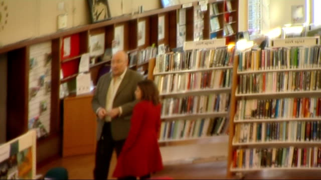 camden council approves first community managed libraries; people browsing books inside library close shot hands flicking through book **siddiq... - display cabinet stock videos & royalty-free footage