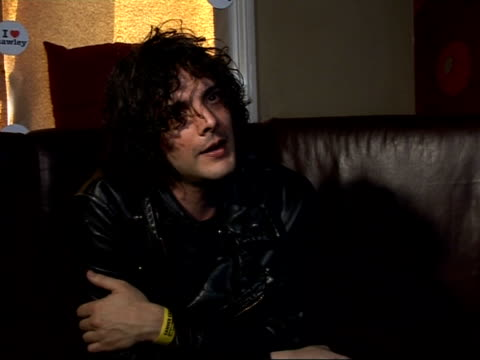 interviews with band members england london camden hawley arms int peter hayes interview sot talks about camden crawl music festival / his band asked... - t in the park stock-videos und b-roll-filmmaterial