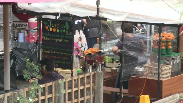camden market food stalls face closure england london camden ext various shots camden lock food stalls and people eating and drinking - 通行止め点の映像素材/bロール