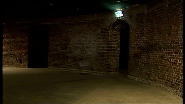 vidéos et rushes de camden roundhouse refurbishment: opening date announced; narrow brick corridors in basement of roundhouse circular brick 'cellar' in basement... - étroit
