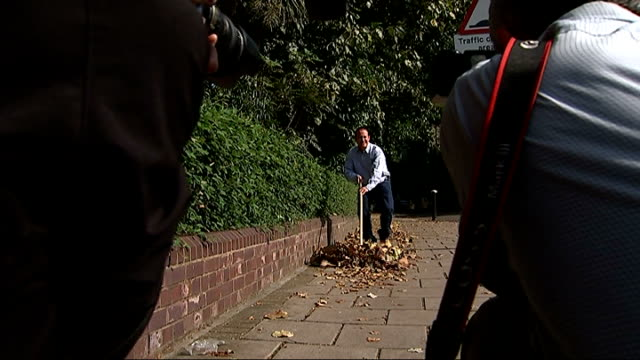 Camden street sweeper wins National Lottery ENGLAND London Camden EXT Various shots Joseph Whiting sweeping leaves on street including lottery balls...