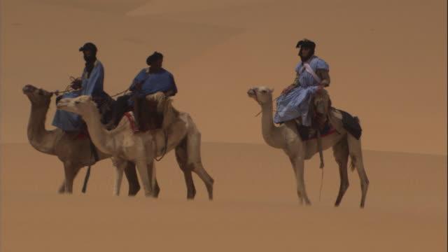 camel drivers traverse the sahara desert. - mauritania stock videos & royalty-free footage