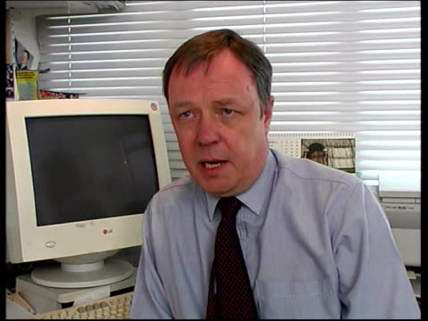 camelot profits fall itn alasdair buchan looking at newsletter and interview sot talks of reasons for fall in sales of lottery tickets - newsletter stock videos & royalty-free footage