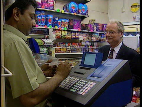 london national heritage sec chris smith mp filling in lottery ticket smith along to counter and paying ext david rigg speaking to press millbank int... - lottery stock videos and b-roll footage