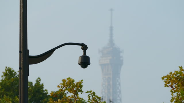 cctv camera and eiffel tower, paris, ile de france, france - surveillance stock videos and b-roll footage