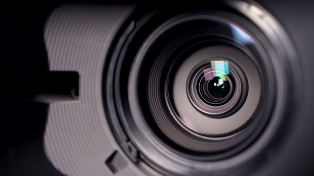 camera and lens zoom, close-up photo, closeup shot of professional video camera, with its lens zooming in and out. - television camera stock videos and b-roll footage