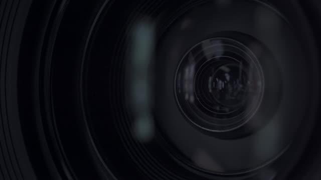 vídeos de stock, filmes e b-roll de câmera e lente zoom, close-up - câmera de filmar
