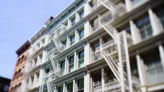 stockvideo's en b-roll-footage met camera captured rows of loft buildings along the street in soho district at new york city ny usa on may 18 2019. - loft
