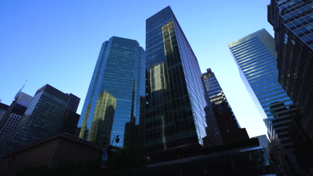 camera captures 42nd street skyscrapers in the dusk at midtown manhattan new york city. - 42nd street stock videos & royalty-free footage