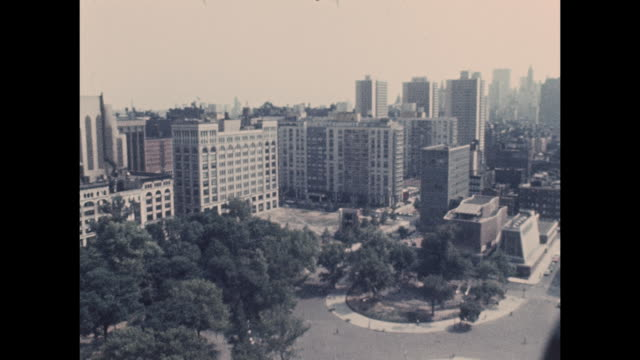 a camera captures aerial footage of washington square park and midtown manhattan from the 1960õs era - aerial or drone pov or scenics or nature or cityscape stock-videos und b-roll-filmmaterial