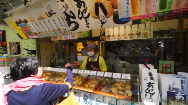 camera captures an agemanju (deep-fried cake) shop  kokonoe - bean stock videos and b-roll footage
