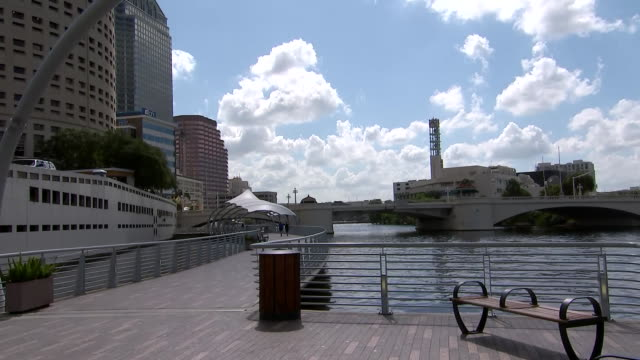 camera captures an establishing shot of the pedestrian trail of tampaõs riverwalk, along the hillsborough river in tampa, florida. - music or celebrities or fashion or film industry or film premiere or youth culture or novelty item or vacations stock videos & royalty-free footage