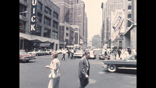 camera captures an intersection of midtown manhattan in the 1960s. - manhattan stock videos & royalty-free footage