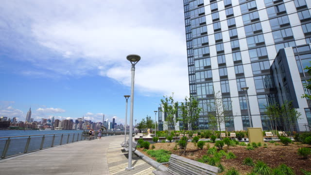 tu camera captures boardwalk and new highrise residence at east river side at brooklyn. - waterfront stock videos & royalty-free footage