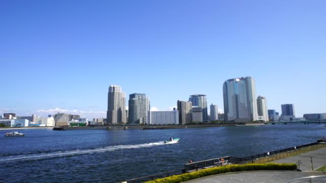 Camera captures cityscape of Etchujima and Toyosu at Koto, Tokyo, beyond Harumi Canal. Image was captured from Tsukuda, Chuo, Tokyo, Japan.