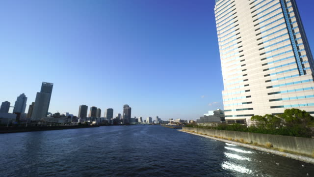 Camera captures cityscapes at both side of Harumi Canal. Tukishima, Chuo ward is at left side and Toyosu Koto ward is at the right side. Image was captured from Harumibashi Bridge.