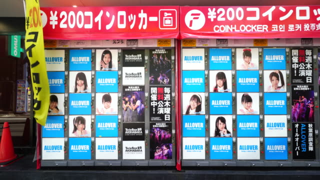 Camera captures Coin lockers along the street in Akihabara, Chiyoda-ku Tokyo. Some advertisement are displayed on the lockers door.