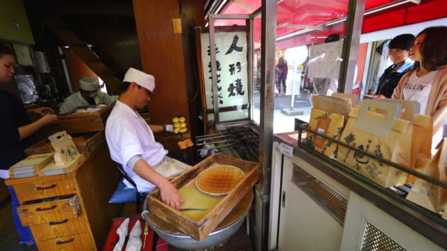 Camera captures cooking process of Ningyou-yaki (small snack cake) at Kameya, which is one of traditional Ningyoyaki maker in Asakusa Nakamise-dori.