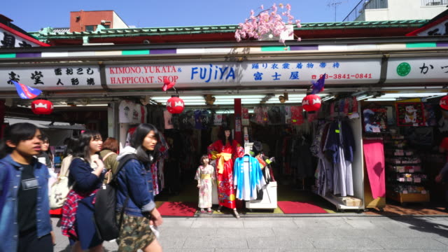 Camera captures display dolls in front of traditional gift shop at Nakamise-dori, which are wearing the Yukata (Japanese Casual Summer Kimono).