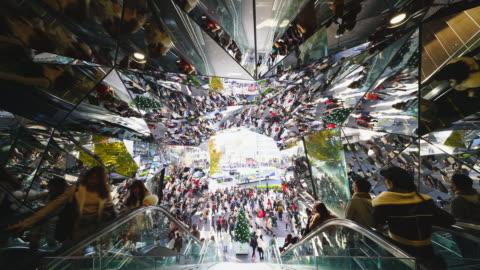 camera captures entrance escalator of tokyu plaza omotesando harajuku, which are surrounded by faceted mirrors walls like a kaleidoscope at harajuku tokyo japan – november. 26 2017. - mirror stock videos & royalty-free footage