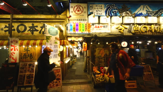 camera captures entrance of bunka-yokocho alley at yurakucho sanchoku inshokugai, tokyo. evening commuter are crossing the entrance of bunka-yokocho. - lantern stock videos & royalty-free footage