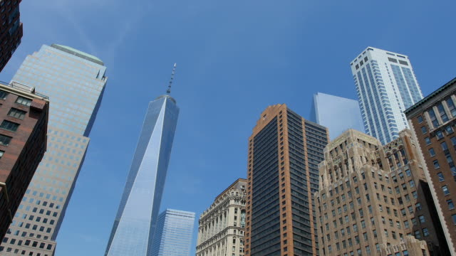 tu camera captures freedom tower and down town manhattan buildings. - tilt stock videos & royalty-free footage
