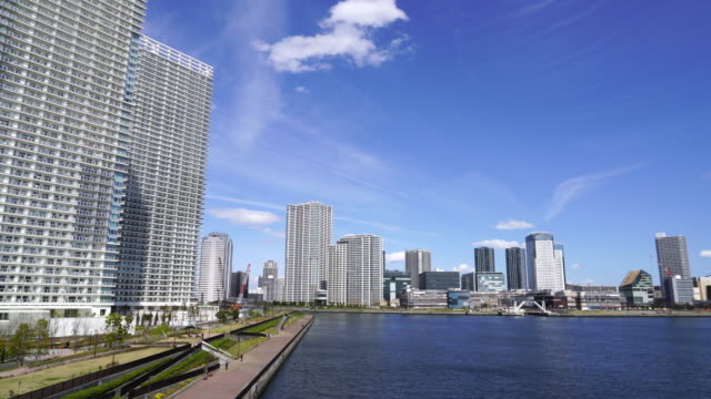 camera captures high-rise buildings at both side of harumi canal at chuo, tokyo. harumi ward is at left side and toyosu ward is at the right side. - tokyo bay stock videos and b-roll footage