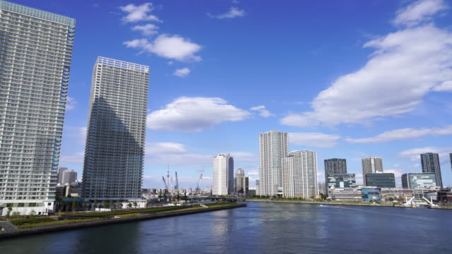 Camera captures high-rise buildings at both side of Harumi Canal at Chuo, Tokyo. Harumi ward is at left side and Toyosu ward is at the right side.