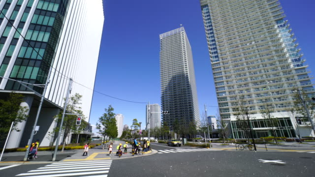 Camera captures high-rise residence buildings at Harumi 2 Chome intersection at Harumi, Chuo, Tokyo, Japan.