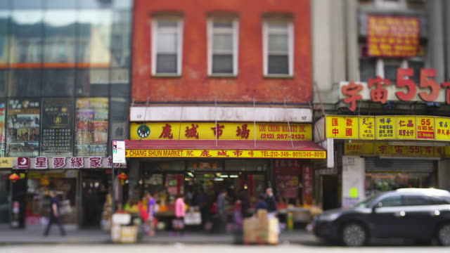 camera captures many signboards of stores, chinese restaurants, vegetable store etc. along the street in chinatown at new york city ny usa on may 22 2019. - chinese language stock videos & royalty-free footage