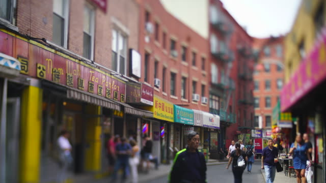 camera captures many signboards of stores, chinese restaurants, vegetable store etc. along the narrow street among the rows of buildings in chinatown at new york city ny usa on may 22 2019. - chinese language stock videos & royalty-free footage