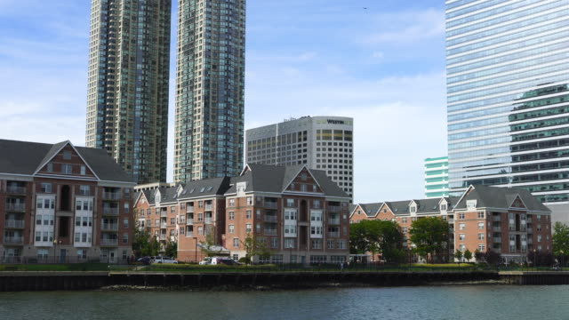 PAN Camera captures New Jersey waterfront high-rise residential buildings.