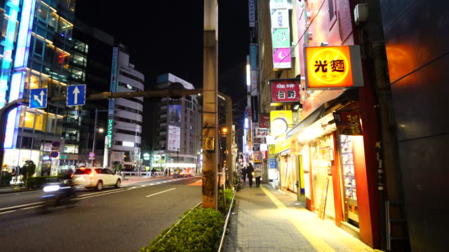 camera captures night scene of meiji-dori at ikebukuro district after the midnight in toshima-ku tokyo. - 日本語の文字点の映像素材/bロール