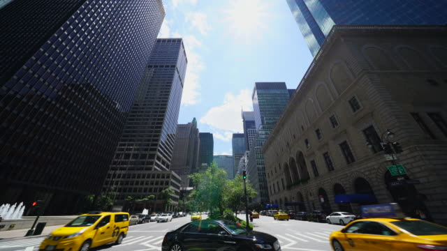 Camera captures Park Avenue Traffic among the Midtown Manhattan skyscrapers at New York City.